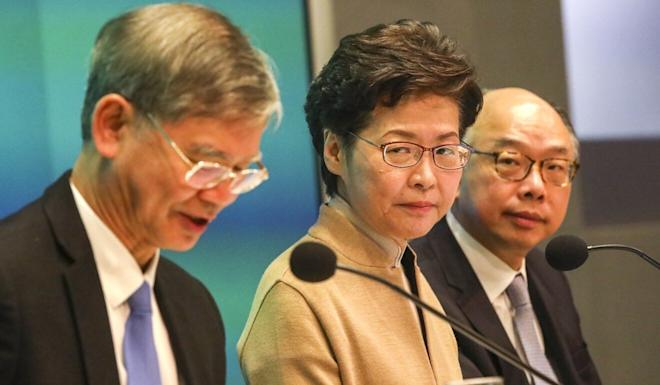 (From left) Law Chi-kwong, Hong Kong Chief Executive Carrie Lam and Secretary for Transport and Housing Frank Chan. Photo: Felix Wong
