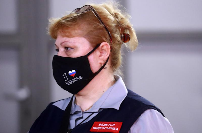 MOSCOW, RUSSIA - JUNE 9, 2020: A staff worker in a face mask at a station of the Moscow Underground (Metro) on the first day of lockdown being lifted in the capital during the pandemic of the novel coronavirus disease (COVID-19). People, including those over 65 and people with health conditions, are allowed to leave home, however wearing face masks and observing social distancing rules in public remains mandatory. Commuters and motorists no longer need to apply for digital permits to use public transport or own motor vehicles. Service businesses, such as hairdressers', beauty salons, photo studios, employment agencies and various public organisations are resuming their work. As of 9 June 2020, Russia has reported more than 477,000 confirmed cases of the novel coronavirus infection, with more than 197,000 confirmed cases in Moscow. Sergei Fadeichev/TASS (Photo by Sergei Fadeichev\TASS via Getty Images)
