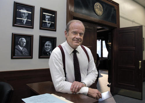 "In this photo taken July 27, 2011, actor Kelsey Grammer poses for a photo while filming ""Boss"" in Chicago. Grammer plays Tom Kane, the powerful mayor of Chicago who is more than willing throw his political weight around. The new dramatic series debuts Friday night Oct. 21. (AP Photo/M. Spencer Green)"