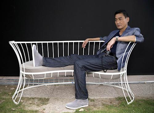 FILE - Actor Tony Leung Ka-Fai, poses for portraits for the film 'Tai Chi 0' at the 69th edition of the Venice Film Festival in Venice, Italy, in this file photo dated Thursday, Aug. 30, 2012. Tony Leung Ka Fai, known for his roles in such auteur films as ''The Lover,'' plays the village tai chi master, whose job it is to defend the town from the modern intruder while protecting the village's martial arts tradition, in this movie which incorporated comic book-style graphic and heavy metal music. (AP Photo/Domenico Stinellis, file)