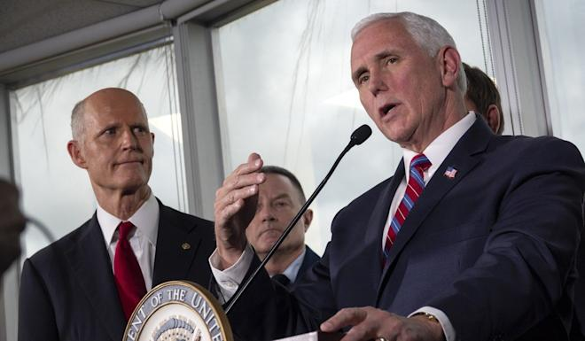 US Vice-President Mike Pence speaks about the outbreak on Saturday in Fort Lauderdale, Florida. At left is Senator Rick Scott, Republican of Florida. Photo: EPA-EFE
