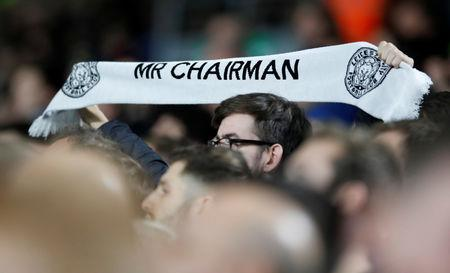 Soccer Football - Premier League - Fulham v Leicester City - Craven Cottage, London, Britain - December 5, 2018  Leicester City fan holds a scarf in tribute to the late chairman Vichai Srivaddhanaprabha  REUTERS/David Klein/Files