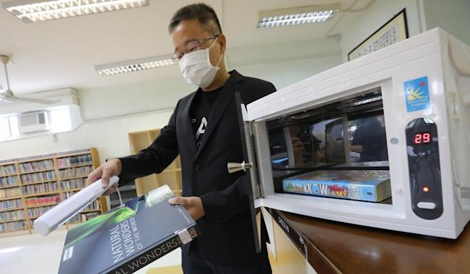 An ultraviolet light machine disinfects books at the ELCHK Yuen Long Lutheran Secondary School. Photo: Felix Wong