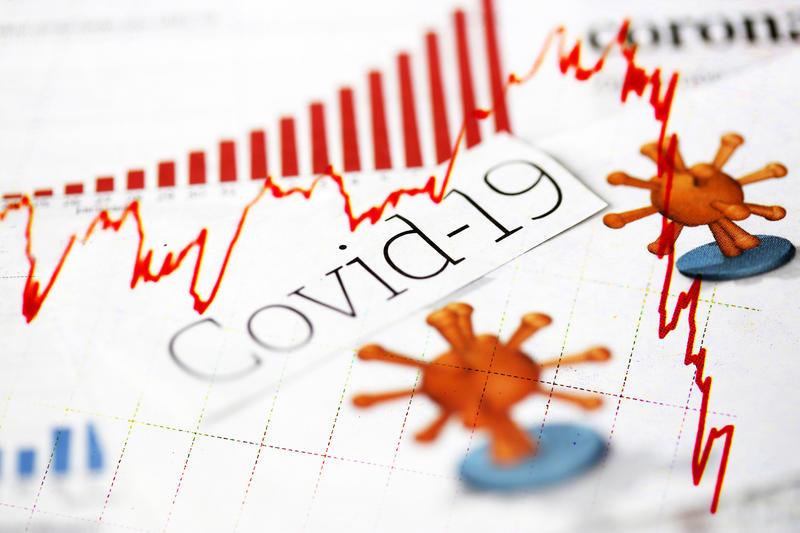 Coronavirus, covid-19, newspaper headlines, news articles and declining red stock market trend