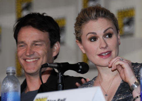 Anna Paquin speaks as actor Stephen Moyer looks on at the True Blood panel on the third day of Comic-Con convention held at the San Diego Convention Center on Saturday, July 14, 2012, in San Diego. (Photo by Denis Poroy/Invision/AP)