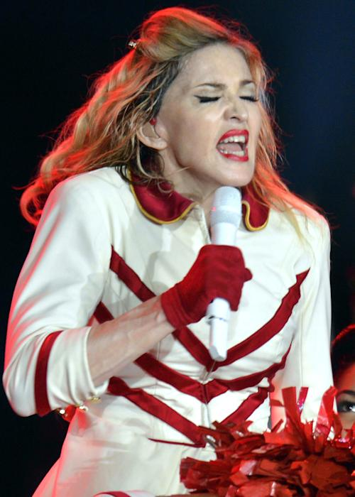 In this picture taken Aug. 18. 2012, US singer Madonna performs one stage during a concert in Zurich, Switzerland. (AP Photo/Keystone/Walter Bieri)