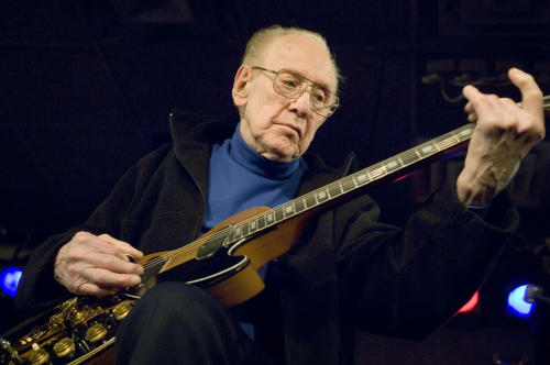 FILE - In this Feb. 26, 2007 file photo, Guitar legend Les Paul performs at the Iridium Jazz Club in New York. Les Paul was a renown musician also known for his innovations on the solid body electric guitar and multitrack recording. The man who helped pave the way for rock 'n' roll is finally getting a permanent exhibit on June 9, 2013 at the Waukesha County Museum in his Wisconsin hometown. (AP Photo/ Colin Archer, file)