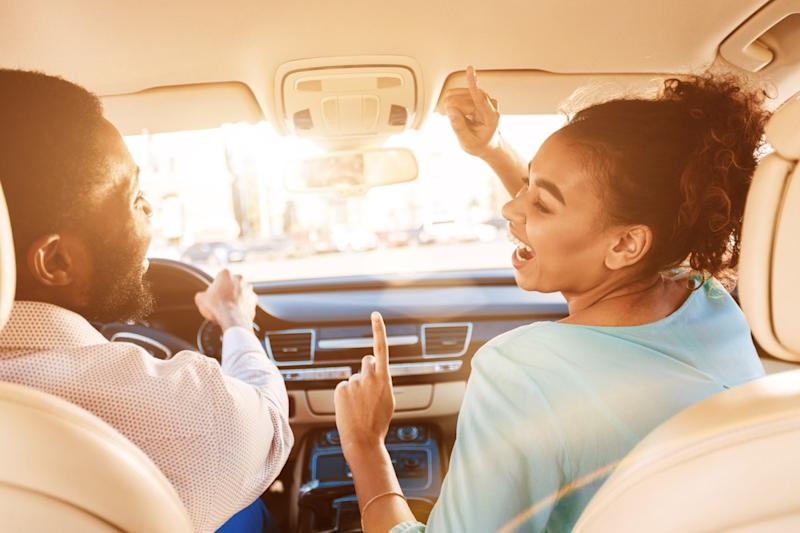 people singing in a car