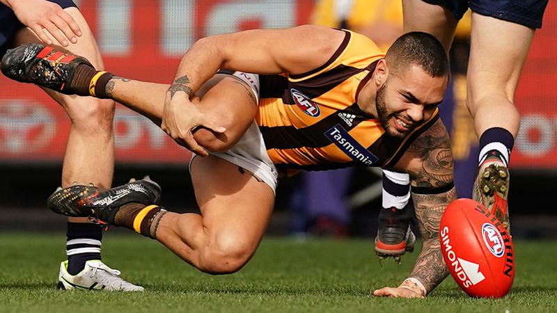 Jarman Impey clutched his knee in anguish after the horrifying injury. (Photo by Scott Barbour/Getty Images)