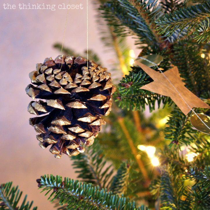"<p>Create this gilded pine cone with a little metallic paint in just a few minutes!<span class=""redactor-invisible-space""></span></p><p><em><a href=""http://www.thinkingcloset.com/2013/12/19/gold-brushed-pine-cone-ornaments-with-myfavoritebloggers/"" target=""_blank""></a></em>See more at <a href=""http://www.thinkingcloset.com/2013/12/19/gold-brushed-pine-cone-ornaments-with-myfavoritebloggers/"" target=""_blank"">The Thinking Closet </a>.</p>"