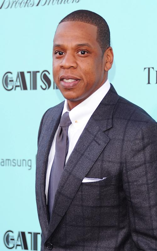 "FILE - In this May 1, 2013 file photo, Jay-Z attends ""The Great Gatsby"" world premiere at Avery Fisher Hall in New York. The rap mogul is defending himself against a growing criticism over his collaboration with the luxury store Barneys New York amid allegations the store racially profiled two customers. (Photo by Evan Agostini/Invision/AP, File)"