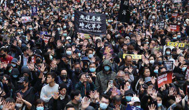 Anti-government protesters march on January 1. Photo: Sam Tsang