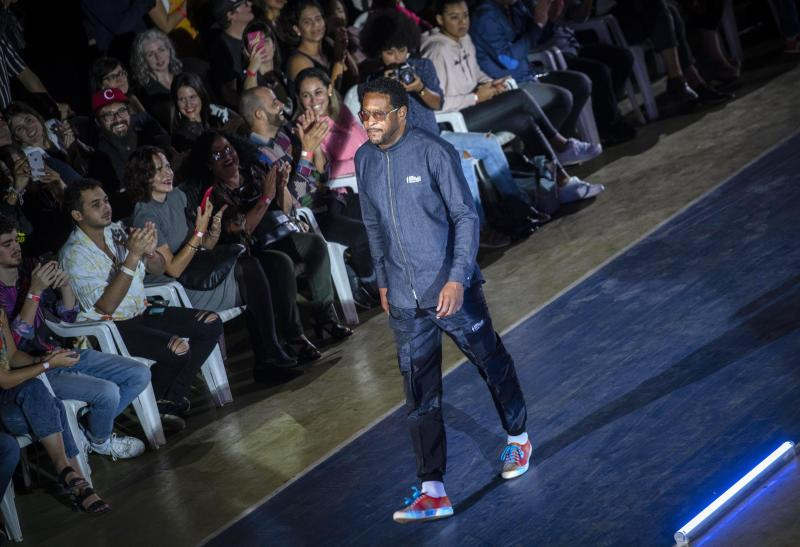 """Cuban track and field legend Javier Sotomayor wears a creation from """"Clandestina,"""" the first Cuban independent urban fashion brand, during his launches for 2020 collection called Sports Glories in Havana, Cuba, Friday, Nov. 22, 2019. (AP Photo/Ramon Espinosa)"""