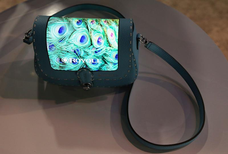 The prototype Royole FlexPai purse with a fully flexible display is shown off at CES International, Tuesday, Jan. 8, 2019, in Las Vegas. (AP Photo/Ross D. Franklin)