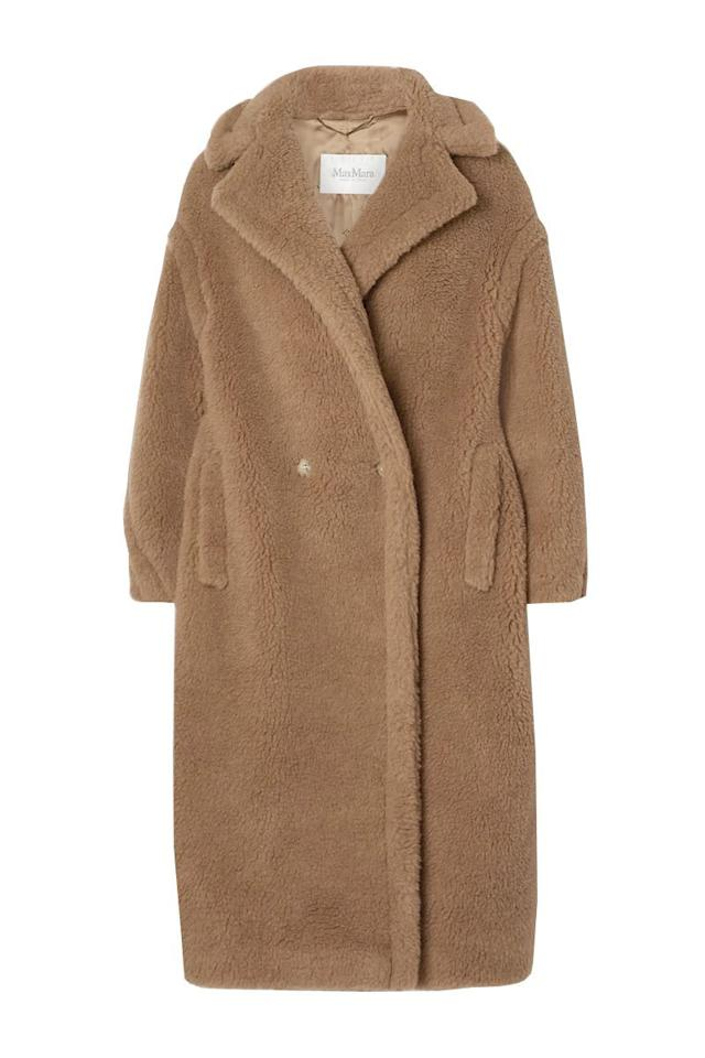 """<p><strong>Max Mara</strong></p><p>net-a-porter.com</p><p><strong>$3690.00</strong></p><p><a href=""""https://go.redirectingat.com?id=74968X1596630&url=https%3A%2F%2Fwww.net-a-porter.com%2Fen-us%2Fshop%2Fproduct%2Fmax-mara%2Fteddy-bear-icon-camel-hair-and-silk-blend-coat%2F1146974&sref=https%3A%2F%2Fwww.harpersbazaar.com%2Ffashion%2Ftrends%2Fg34113004%2Fbest-teddy-bear-coats%2F"""" target=""""_blank"""">Shop Now</a></p><p>The OG of the teddy bear coats has been worn by some of your favorite It girls and can be yours to rock as well.</p>"""