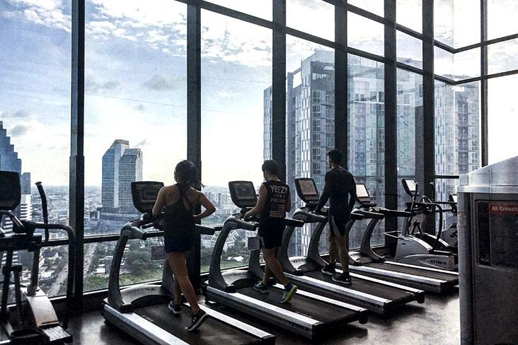 Gym members on treadmills — Pictures by CK Lim