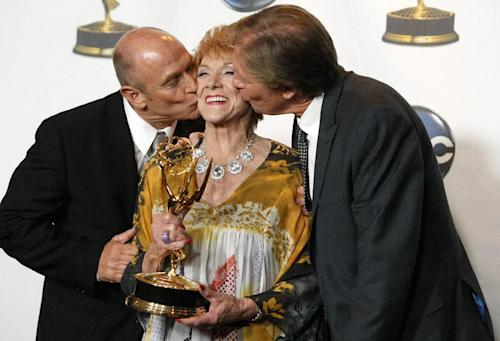"FILE - In this June 20, 2008 file photo, actress Jeanne Cooper, center, gets a kiss from Corbin Bernsen, left, and Collin Bernsen in the press room at the Daytime Emmy Awards in Los Angeles. CBS says soap opera star Jeanne Cooper has died. She was 84. Cooper played grande dame Katherine Chancellor on CBS' ""The Young and the Restless"" for nearly four decades. (AP Photo/Dan Steinberg, File)"