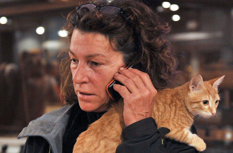 French yachtswoman Florence Arthaud makes a call with her cat on her shoulder in Marseille in 2011. Lost your cat? Your grandmother? Or are you injured in a car crash, unable to call for help because your phone battery is dead? Never fear, a mobile solution is near