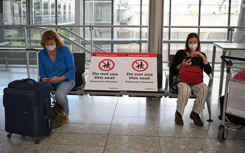 Passengers at Heathrow - AFP