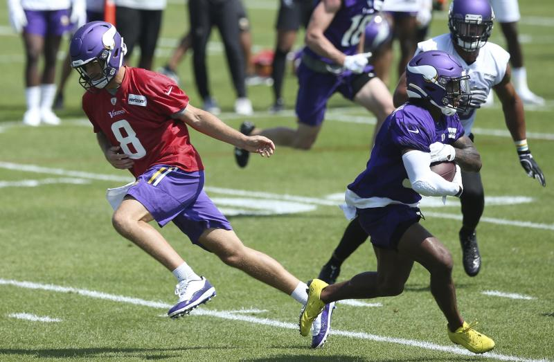 The Minnesota Vikings are hoping to ease some of the burden on quarterback Kirk Cousins, left, this season. (AP)