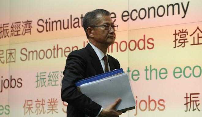 Paul Chan spoke to the press after the delivery of his budget speech. Photo: K.Y. Cheng