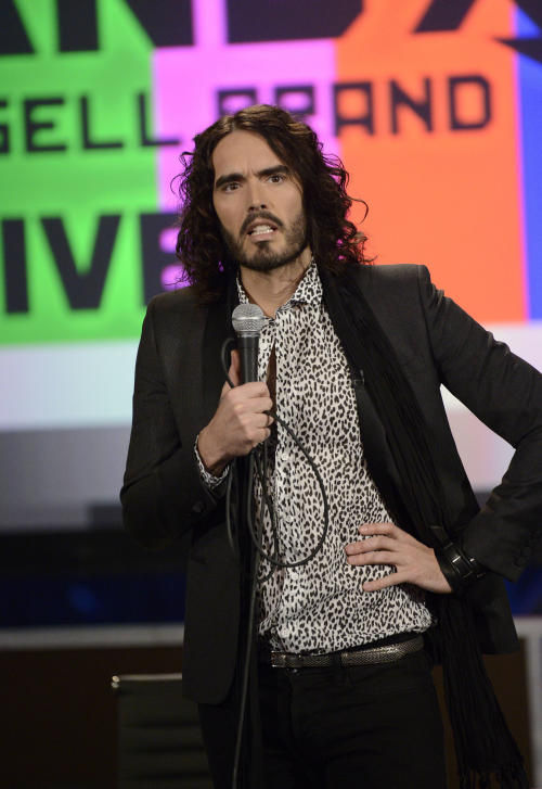 "This March 21, 2013 photo released by FX shows Russell Brand, host of the FX series ""Brand X with Russell Brand."" The British comedian announced Thursday, June 6, that he's launching a world comedy tour focusing on Che Guevara, Gandhi, Malcolm X and Jesus Christ. Brand says the show examines ""the importance of heroes in this age of atheistic disposability."" The ""Messiah Complex"" tour is set to begin August 15 in Abu Dhabi and wrap up Dec. 9 in Iceland. (AP Photo/FX, Ellis O'Brien)"