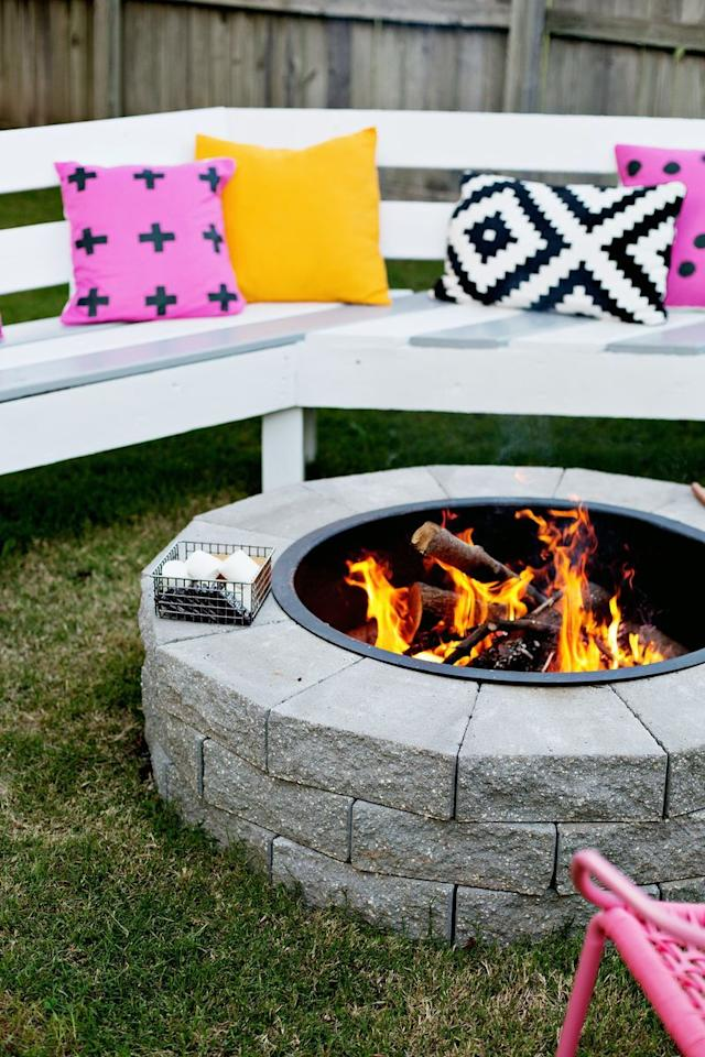 """<p>This easy-peasy fire pit can be knocked out in an afternoon, so you can be toasting marshmallows by evening. Use two or three layers of landscaping stone for a custom, finished look.</p><p><strong>Get the tutorial at <a href=""""https://abeautifulmess.com/2014/09/make-your-own-fire-pit-in-4-easy-steps.html"""" target=""""_blank"""">A Beautiful Mess</a>.</strong></p><p><a class=""""body-btn-link"""" href=""""https://www.amazon.com/Titan-Outdoors-Diameter-Steel-Liner/dp/B06XXLNWQX/?tag=syn-yahoo-20&ascsubtag=%5Bartid%7C10050.g.31966151%5Bsrc%7Cyahoo-us"""" target=""""_blank"""">SHOP METAL FIRE PIT INSERT</a></p>"""