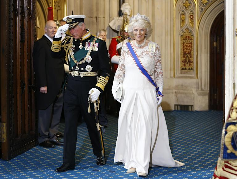 Britain's Prince Charles, left, and Camilla, The Duchess of Cornwall as they leave after the State Opening of Parliament, at the Houses of Parliament in London, Wednesday, May 8, 2013. The State Opening of Parliament marks the formal start of the parliamentary year, the Queen delivered a speech which set out the government's agenda for the coming year. (AP Photo/Kirsty Wigglesworth, Pool)
