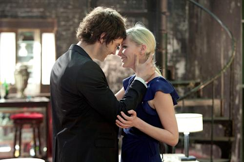 "This film image released by Millennium Entertainment shows Jim Sturgess, left, and Kirsten Dunst in a scene from ""Upside Down."" (AP Photo/Millennium Entertainment)"