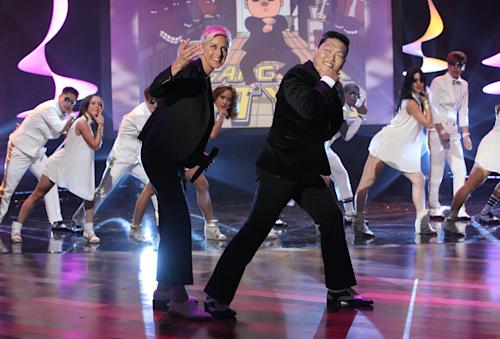 "In this photo released by Warner Bros., talk show host Ellen DeGeneres, center left, joins Korean pop star PSY as he performs his super hit ""Gangnam Style"" during a taping of ""The Ellen DeGeneres Show"" on Tuesday, Sept. 18, 2012 in Burbank, Calif. This episode of ""The Ellen DeGeneres Show"" airs on Wednesday, Sept. 19. (AP Photo/Warner Bros., Michael Rozman)"