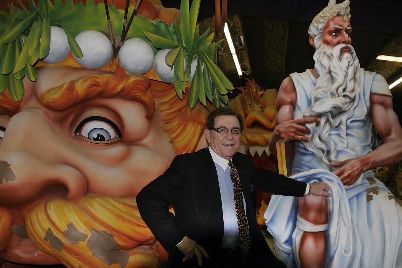 "FILE - In this Feb. 7, 2007 file photo, Blaine Kern, Sr. poses for a photograph with some of the creations he built for Mardi Gras floats in New Orleans.  The man known as ""Mr. Mardi Gras"" for helping to convert the annual pre-Lenten celebration into a giant event in New Orleans has died. News outlets report that Blaine Kern Sr. died Thursday, June 25, 2020. For decades, Kern's work helped boost New Orleans' Carnival.   (AP Photo/Bill Haber, File)"