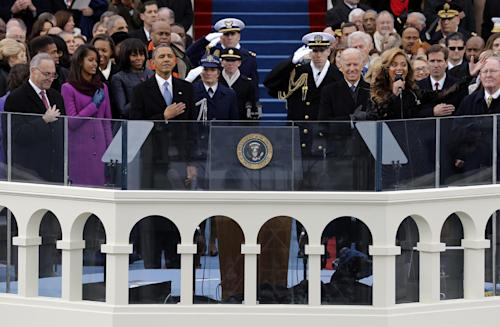 President Barack Obama, left and Vice President Joe Biden listen as singer Beyonce sings the National Anthem at the ceremonial swearing-in on the West Front of the U.S. Capitol during the 57th Presidential Inauguration in Washington, Monday, Jan. 21, 2013. (AP Photo/Scott Andrews, Pool)