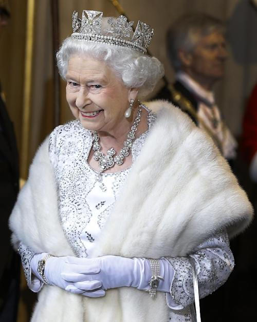 Britain's Queen Elizabeth II smiles as she leaves the State Opening of Parliament, at the Houses of Parliament in London, Wednesday, May 8, 2013. The State Opening of Parliament marks the formal start of the parliamentary year. The Queen delivered a speech which set out the government's agenda for the coming year. (AP Photo/Kirsty Wigglesworth, Pool)