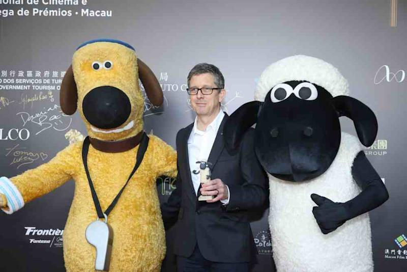 Paul Kewley accompanied by the one and only Shaun the Sheep and Bitzer on the red carpet for the IFFAM Farmageddon gala. ― Picture courtesy of IFFAM