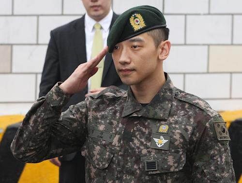 South Korean actor and singer Rain salutes to his fans and media after he served 21 months in the army in front of the Defense Ministry in Seoul, South Korea, Wednesday, July 10, 2103. (AP Photo/Ahn Young-joon)