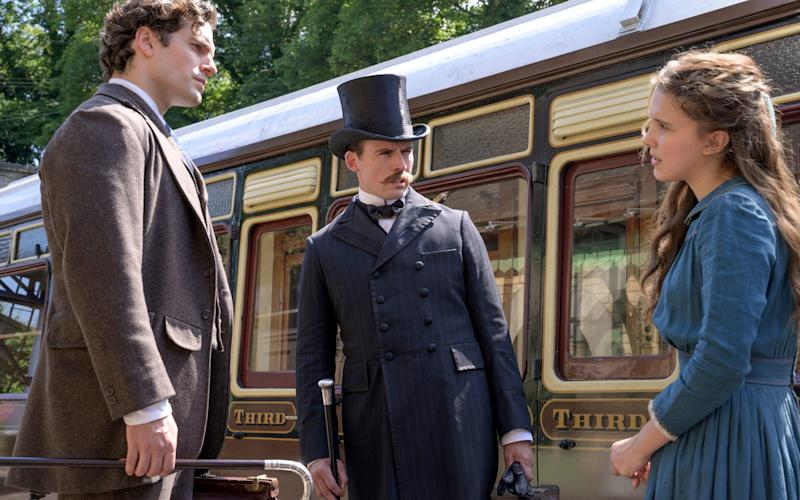 Henry Cavill, Sam Claflin and Millie Bobby Brown in a scene from Enola Holmes - Netflix