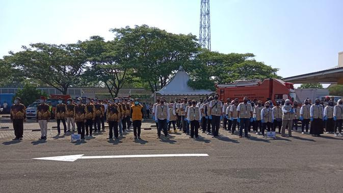 Program Genggam 2,5 juta masker yang melibatkan unsur TNI, Polri, dan Pemerintah Kabupaten Bekasi. (Foto: Liputan6.com/Bam Sinulingga)