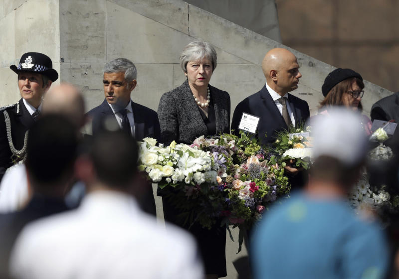 From left, Metropolitan Police Commissioner Cressida Dick, Mayor of London Sadiq Khan, Prime Minister Theresa May and Home Secretary Sajid Javid at Southwark Gateway Needle, on the south side of London Bridge on June 3, 2018, ahead of a minute's silence to mark one year since a deadly vehicle-and-knife attack on London Bridge (Andrew Matthews/PA via AP)