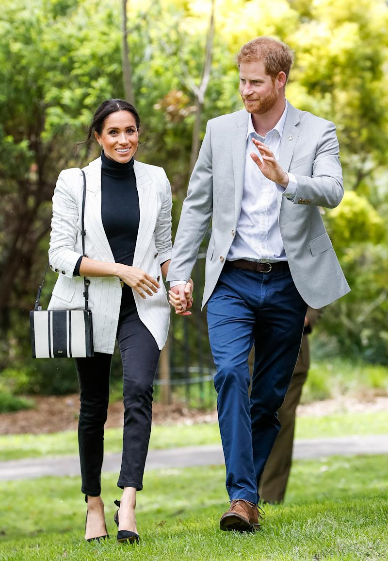 The Duchess of Sussex wearing a blazer and jeans during the Invictus Games Sydney 2018 [Photo: Getty]