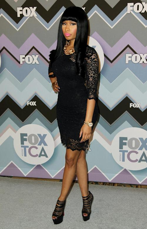 FILE - In this Jan. 8, 2013 file photo, Nicki Minaj arrives at the Winter TCA Fox All-Star Party at the Langham Huntington Hotel, in Pasadena, Calif. Actors and actresses compete separately at awards shows, a tradition some in the industry consider vital for women but others question. Minaj weighed in on the issue during a TCA press tour interview. (Photo by Matt Sayles/Invision/AP)