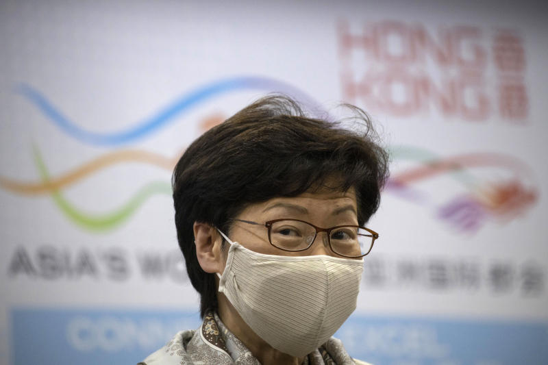 Hong Kong Chief Executive Carrie Lam speaks during a press conference after meeting Chinese leadership in Beijing on Wednesday, June 3, 2020. British Prime Minister Boris Johnson said the United Kingdom stands ready to open the door to almost 3 million Hong Kong citizens, as the city's leader arrived in Beijing on Wednesday for meetings on a planned national security law that has many worried about their future. (AP Photo/Ng Han Guan)
