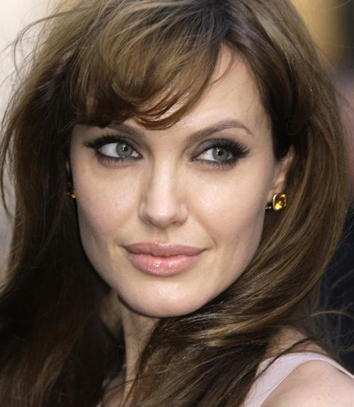 FILE - Actress Angelina Jolie arrives for the British Gala premiere for the film 'Salt', at a central London cinema, in this Aug. 16, 2010 file photo. Jolie authored an op-ed for Tuesday's May 14, 2013 New York Times where she writes that in April she finished three months of surgical procedures to remove both breasts as a preventive measure. She says she's kept the process private but is writing about it now with hopes she can help other women. (AP Photo/Joel Ryan, File)
