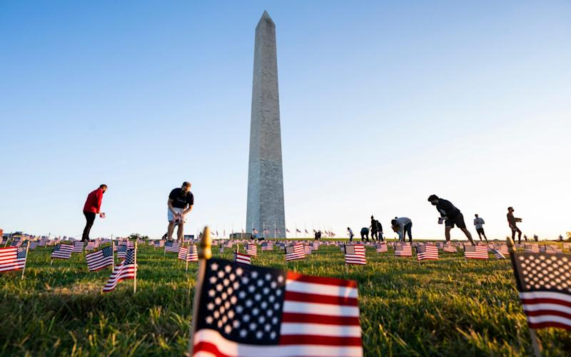 Supporters of the COVID Memorial Project place 20,000 American flags on the National Mall as the US coronavirus death toll reaches 200,000 lives lost to date, in Washington, - Jim Lo Scalzo/EPA-EFE/Shutterstock