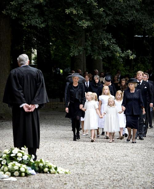 From left: Princess Mabel, Princess Luana, Princess Amalia, Princess Alexia, Princess Zaria, Princess Beatrix and King Willem-Alexander arrive at the church for a private funeral for Prince Friso in Lage Vuursche, central Netherlands, Friday, Aug. 16, 2013. Friso, the younger brother of King Willem-Alexander, died this week due to complications from a 2012 skiing accident. He died on Monday, aged 44. Friso is survived by his wife, Princess Mabel, and two young daughters. (AP Photo/Koen van Weel, Pool)