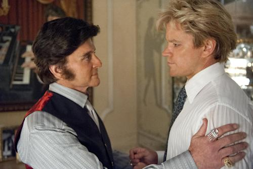 "This film image released by HBO shows Michael Douglas, left, as Liberace, and Matt Damon, as Scott Thorson in a scene from ""Behind the Candelabra."" The Nielsen company said the 2.4 million people who tuned in to the movie's premiere over the holiday weekend represented the network's biggest audience for one of its original movies since ""Something the Lord Made"" in 2004. (AP Photo/HBO, Claudette Barius)"