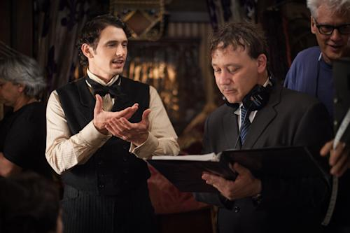 """FILE - This publicity film image released by Disney Enterprises shows James Franco, left, and director Sam Raimi on the set of """"Oz the Great and Powerful."""" Returning to the mystical land of """"The Wizard of Oz"""" apparently takes more than 70 years and hundreds of millions of dollars. Disney will release its anticipated prequel to the 1939 movie on Friday, Feb. 7, 2013. Directed by Raimi, """"Oz the Great and Powerful"""" explores the origins of the wizard (James Franco) and the witches (Mila Kunis, Michelle Williams and Rachel Weisz) in a three-dimensional Oz. (AP Photo/Disney Enterprises, Merie Weismiller Wallace, file)"""