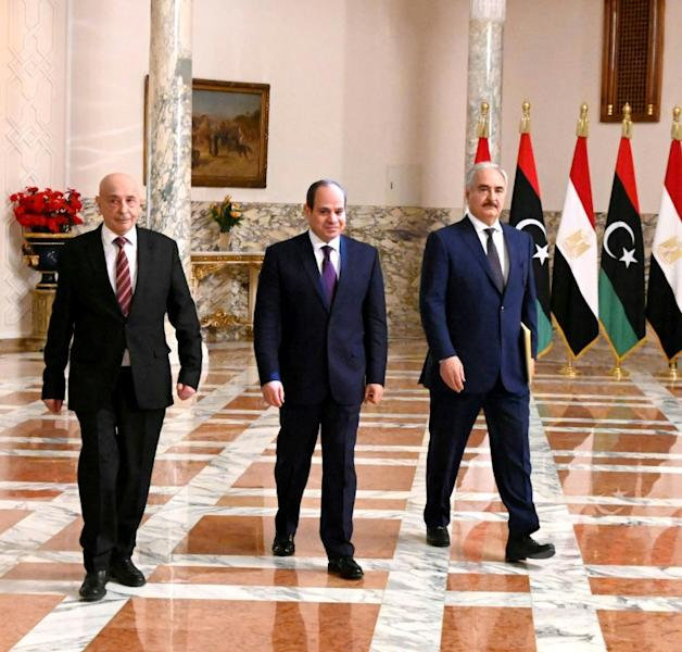 Egyptian President Abdel Fattah al-Sisi (C) met Libyan commander Khalifa Haftar (R) and the Libyan Parliament speaker Aguila Saleh in Cairo earlier this month