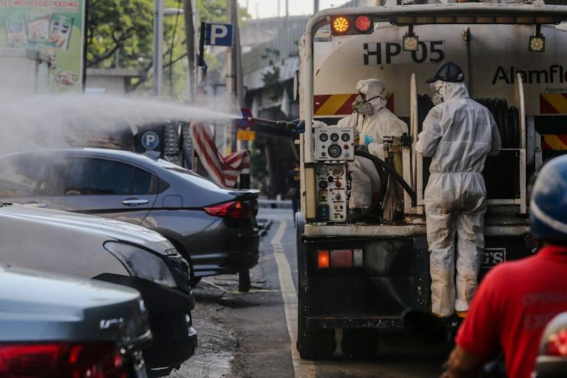 An Alam Flora personnel sprays disinfectant at Pasar Pudu to prevent the spread of the coronavirus in Kuala Lumpur April 1, 2020. — Picture by Firdaus Latif