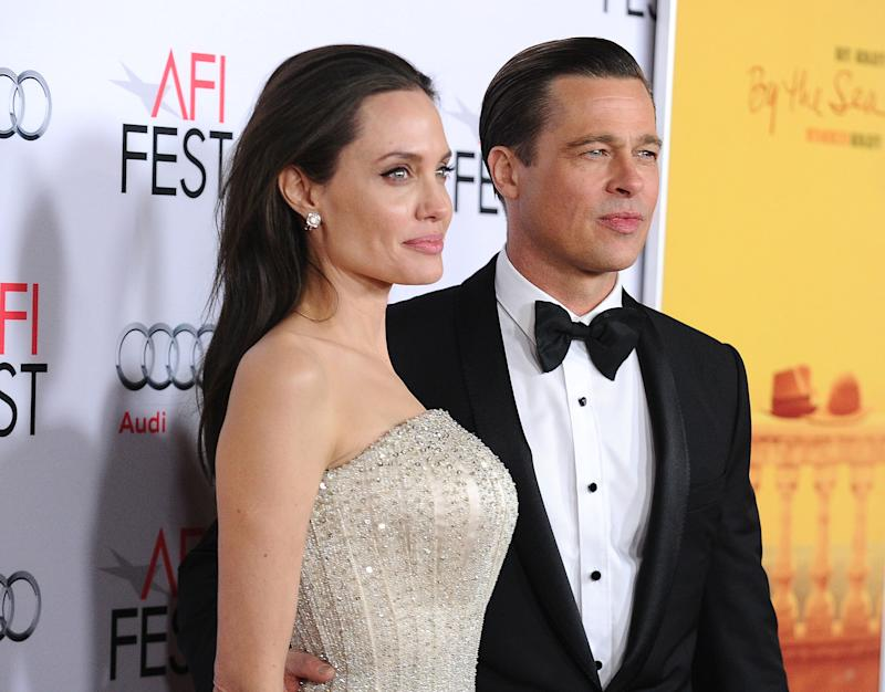 "Angelina Jolie and Brad Pitt attend the premiere of ""By the Sea"" at the 2015 AFI Fest at TCL Chinese 6 Theatres on November 5, 2015 in Hollywood, California."