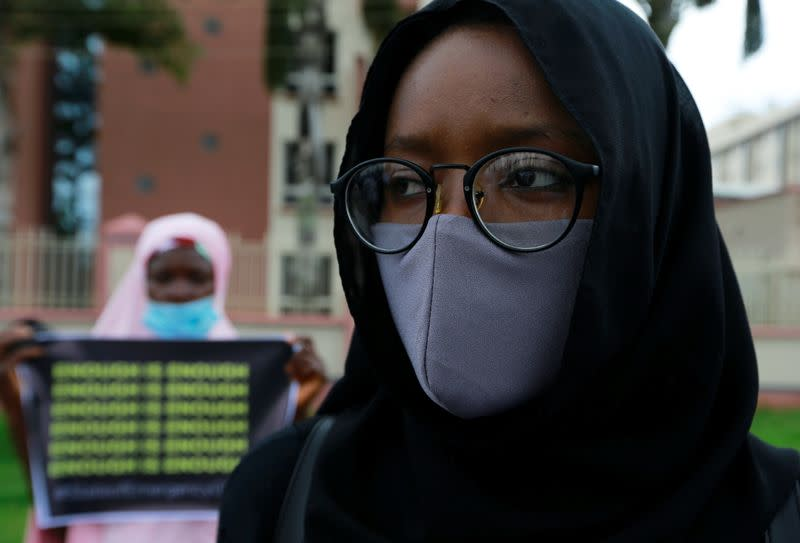 A protester takes part in a demonstration to raise awareness about sexual violence, in Abuja